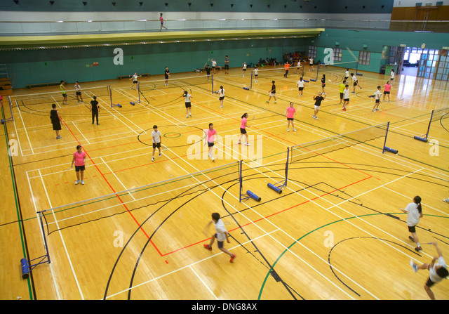 Hong Kong China Island Central Hong Kong Park Sports Centre center badminton courts indoor gymnasium Asian girl - Stock Image