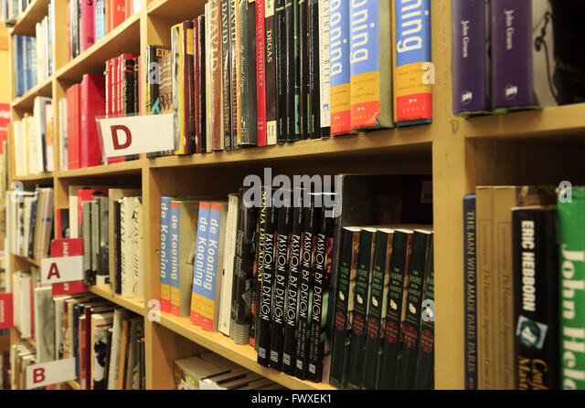 books on shelf in Strand Bookstore in Greenwich Village, Manhattan, New York City, USA - Stock Image