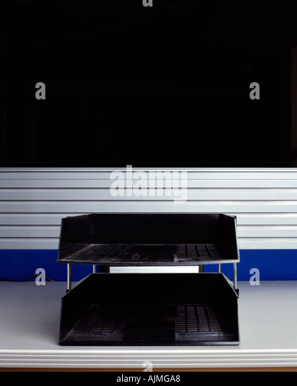 Empty tray on desk - Stock Image