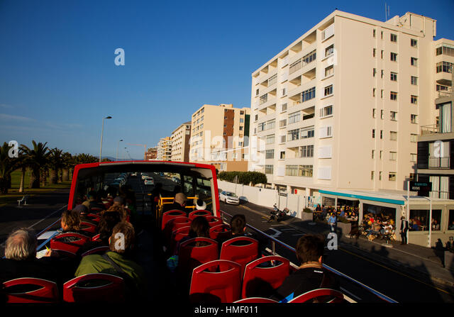 Tourists on the Red Bus Sightseeing Tour parked at Sea Point, one of the most famous beach in Cape Town, South Africa - Stock Image