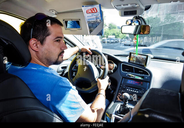 Spain Europe Eurozone Spanish Hispanic MAD Adolfo Suárez Madrid-Barajas Airport taxi cab driver man job inside - Stock Image