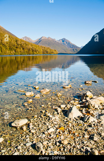Reflection of mountains in Lake Gunn, Fiordland National Park, UNESCO World Heritage Site, South Island, New Zealand - Stock Image