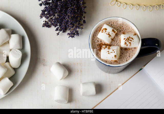 hot cocoa with marshmallow on morning table - Stock Image