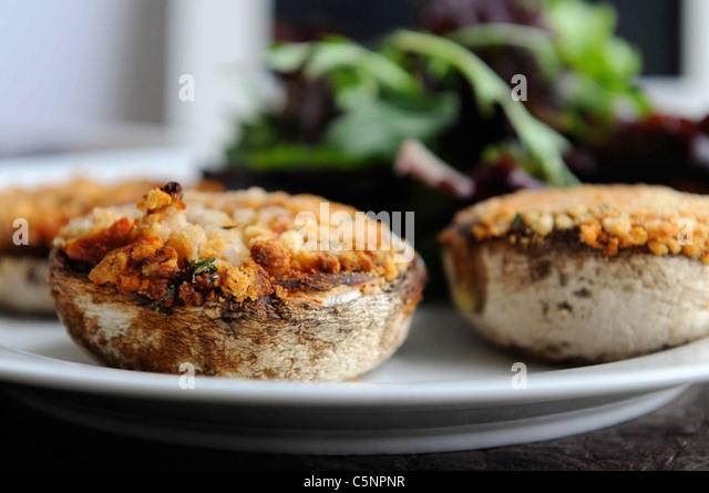 Cheesy stuffed mushrooms - Stock Image