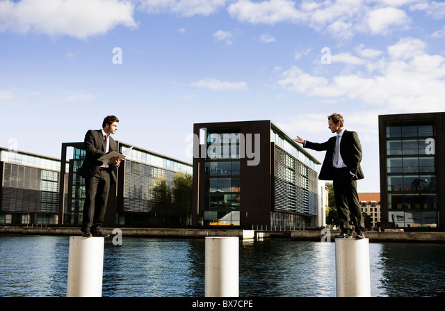 2 men on poles - Stock Image