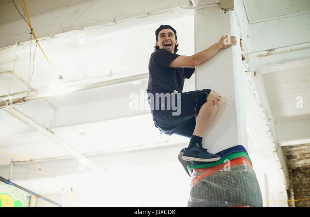 Young man climbing. - Stock Image