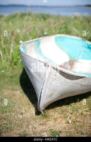 boat on grass field. nautical vessel, transport, environment, grass. - Stock Image