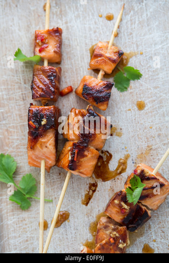 Salmon Teriyaki Skewers with Coriander - Stock Image