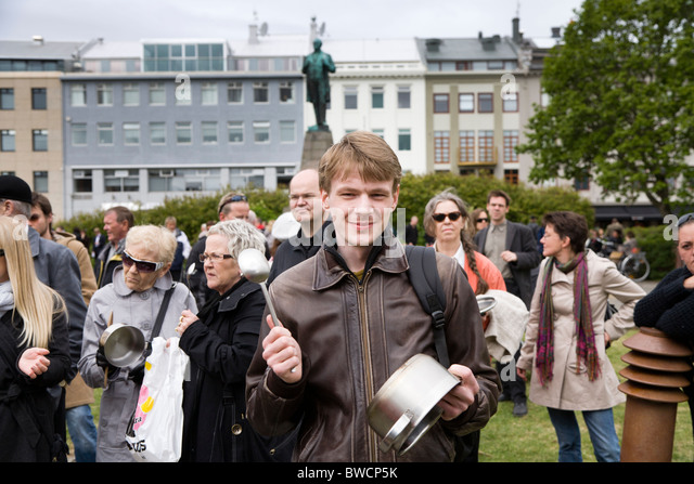 Reykjavik - Iceland, June 9, 2009: People demonstrate outside Althingi, the Icelandic Parliament at Austurvollur. - Stock Image