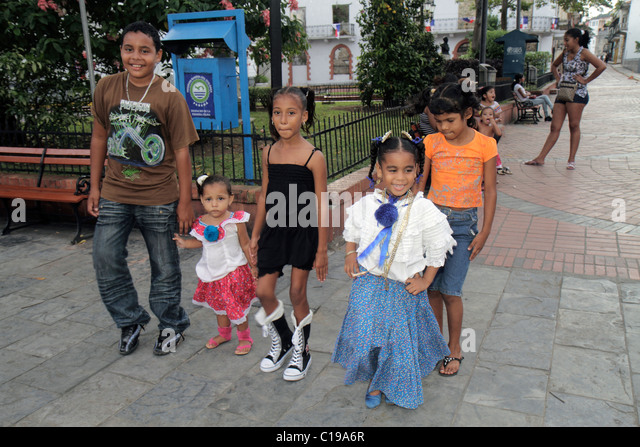 Panama City Panama Casco Viejo San Felipe historic neighborhood park plaza Hispanic boy girl child student sibling - Stock Image