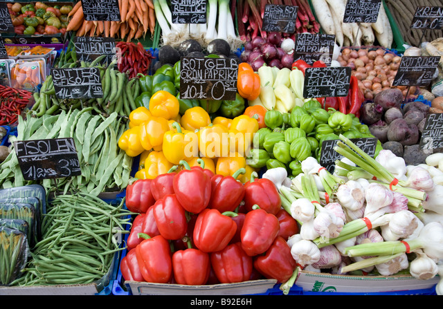 Vegetables displayed on stall at the popular Naschmarkt open air market in Vienna Austria - Stock Image