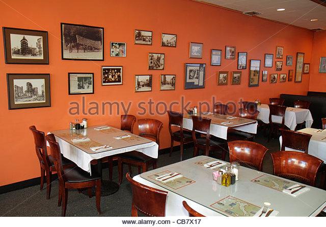 California San Francisco Market Street Little Joe's Italian Restaurant empty dining table place setting framed - Stock Image