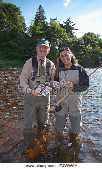 anglers chooses fishing flies whilst fishing for salmon at the river dee, scotland - Stock Image