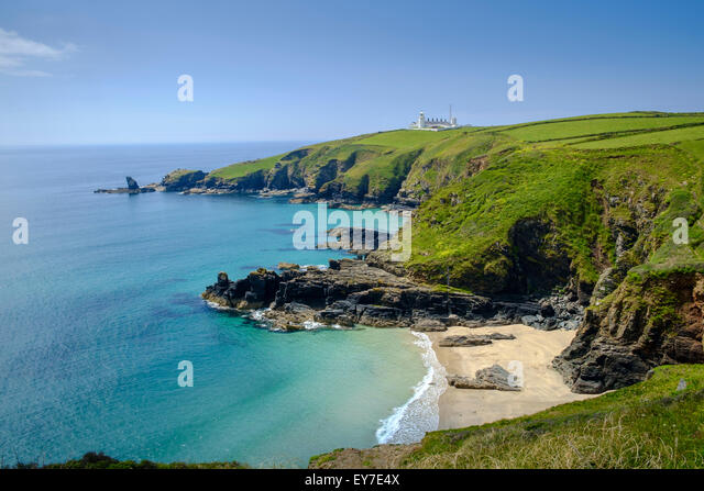Cornwall view of Lizard Point lighthouse, headland and Housel Bay cove beach, Lizard Peninsula coast, Cornwall, - Stock Image