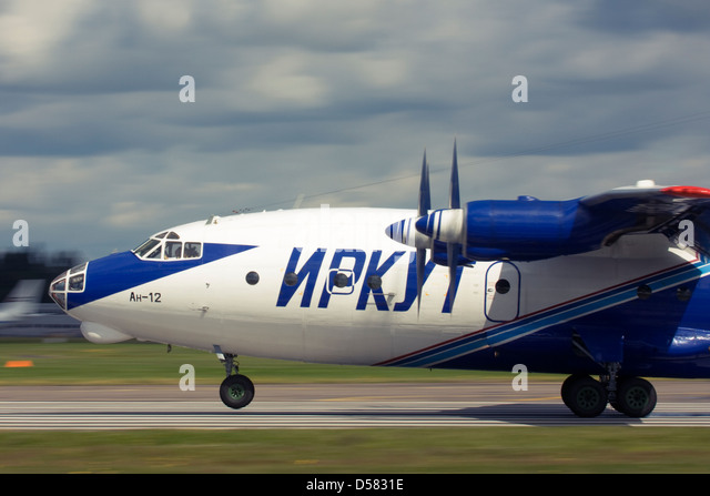 Gromov Air (Irkut-Avia) Antonov An-12 touching down on runway at Farnborough International Airshow 2012 - Stock Image