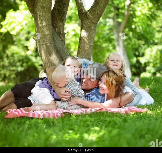 Family having picnic together - Stock-Bilder