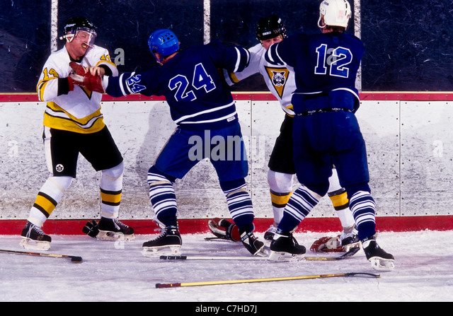 Ice hockey players fighting during a game. - Stock Image