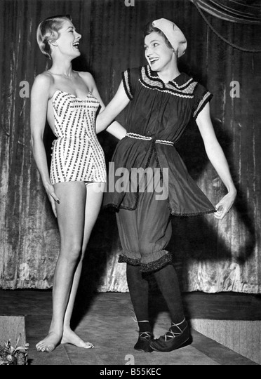 Left Nolla Rose, Miss Pacific 1949 and an old fashioned bathing costume lent by Mrs. Langley Moore from her famous - Stock Image
