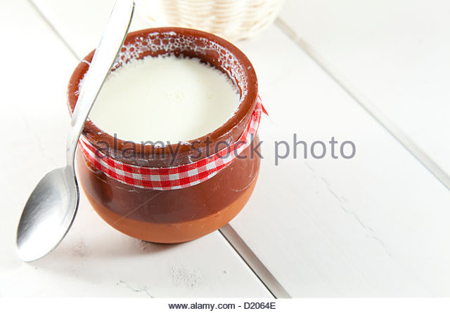 Delicious homemade curd in clay pot made from goat milk - Stock Image