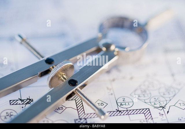 Drawing compass and blueprints - Stock Image