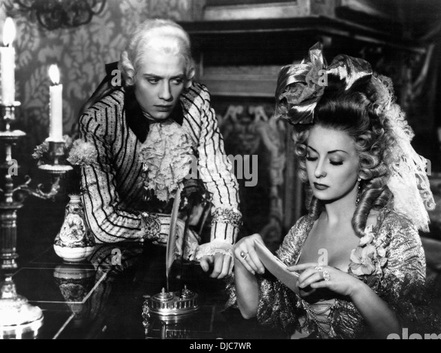 Jacques Dacqmine and Viviane Romance on-set of the Film, The Queen's Necklace, (aka L'Affaire du Collier - Stock Image