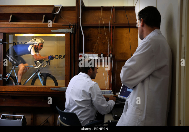 Aerodynamics expert Simon Smart logging results from a wind tunnel test for cycling clothing and racing bicycle - Stock Image