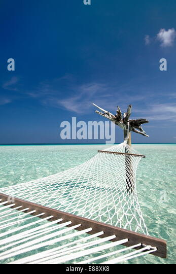 Hammock in tropical lagoon, Maldives, Indian Ocean, Asia - Stock Image