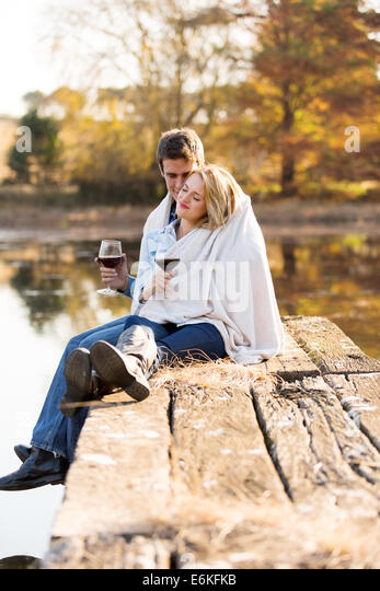 romantic young couple snuggle outdoors in autumn - Stock-Bilder