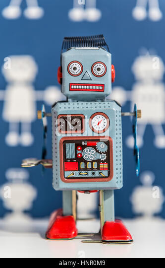 A vintage wind up toy robot, painted in blue and red - Stock Image