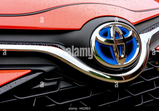 Front bonnet and grille section of a new, limited edition Toyota Yaris Hybrid Orange Edition 2016 motor vehicle. - Stock Image