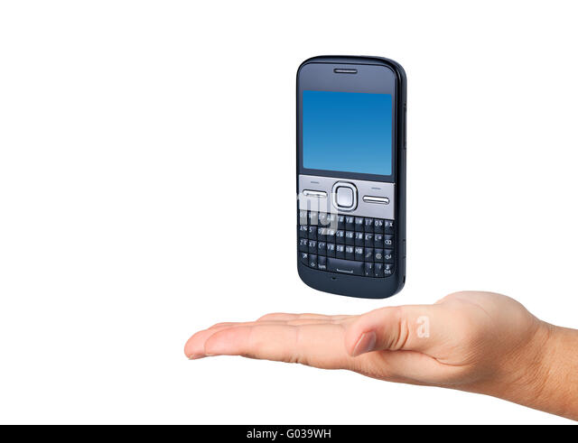 Cell phone in hand isolated on white background. - Stock Image