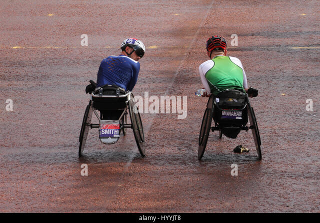 ​​​London, UK 24 April 2016. John Smith (GBR) and Patrick Munahan (IRL) seen at the Mall after finishing the Wheelchair - Stock Image