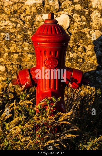 Fire hydrant in evening sunlight, Brittany, France - Stock Image