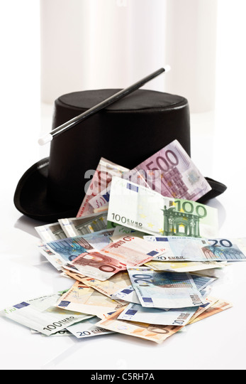 Different Euro bank notes, Top hat and magic wand - Stock Image