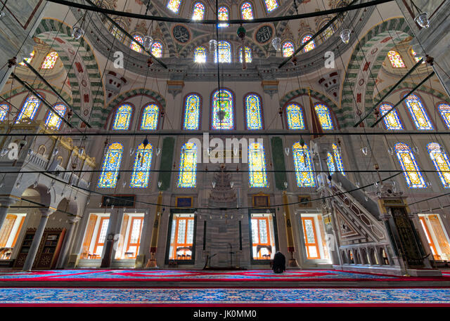 Fatih Mosque, a public Ottoman mosque in the Fatih district of Istanbul, Turkey, with a huge decorated arches and - Stock Image