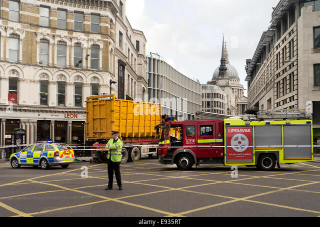 London, UK. 17th October, 2014. Road accident involving a dumpster lorry and cyclist at Ludgate Circus London UK - Stock Image