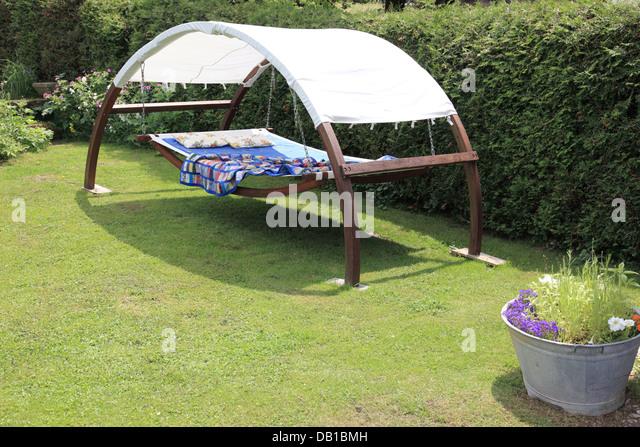 Hammock in garden. Photo by Willy Matheisl - Stock Image