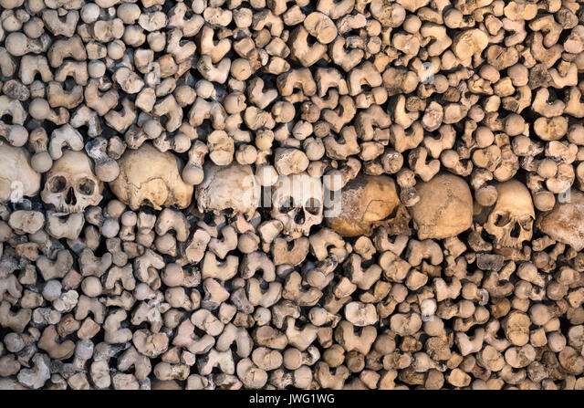 Capela dos Ossos or Chapel of Bones - is one of the best known monuments in Evora, Portugal. It is a small interior - Stock Image