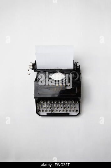 Vintage Typewriter on White Background Antique Journalism Keyboard Paper Still Life Typewriter White Background - Stock Image