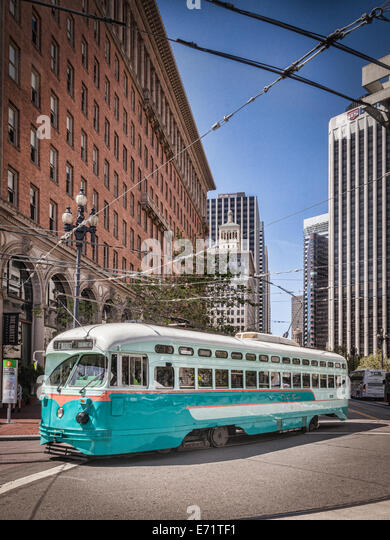 A vintage streetcar turning out of Market Street, San Francisco. - Stock Image