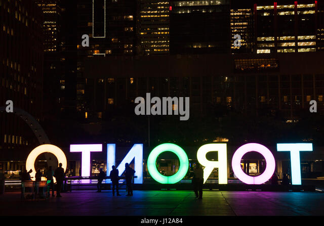 Nathan Phillps Square, Toronto Sign, downtown at night, Toronto, Ontario. TORONTO,CANADA-NOVEMBER 01,2016 - Stock Image