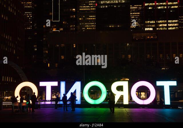 Nathan Phillps Square, Toronto Sign, downtown at night, Toronto, Ontario. TORONTO,CANADA-NOVEMBER 01,2016 - Stock Image
