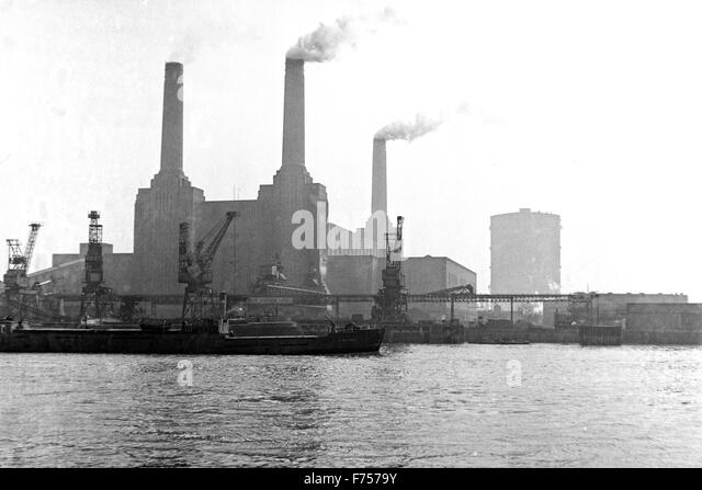 An archival image from 1952 of Battersea Power Station and taken looking over the Thames in London. - Stock Image