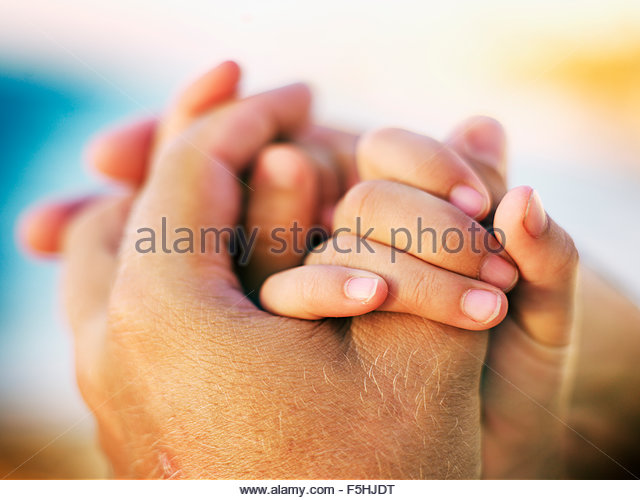 Sweden, Mother and daughter (8-9) holding hands - Stock Image