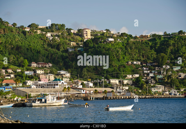 St Vincent Kingstown harbor fishing boats and city landscape - Stock Image