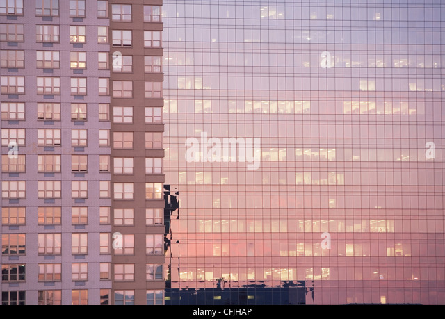 Evening light reflected in office buildings - Stock Image
