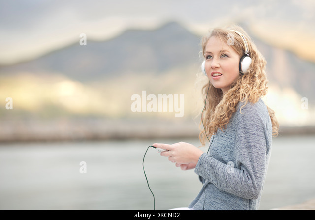 Woman listening to music, Hout Bay, Cape Town, South Africa - Stock Image