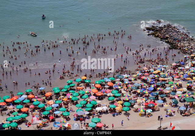 Peru Lima Barranco District Malecon Circuito de playas Playa los Yuyos Pacific Ocean coast aerial view beach crowd - Stock Image