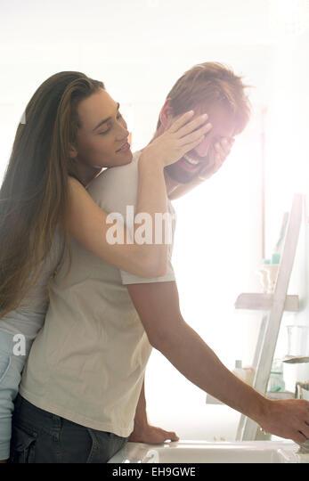 Woman surprising boyfriend - Stock Image