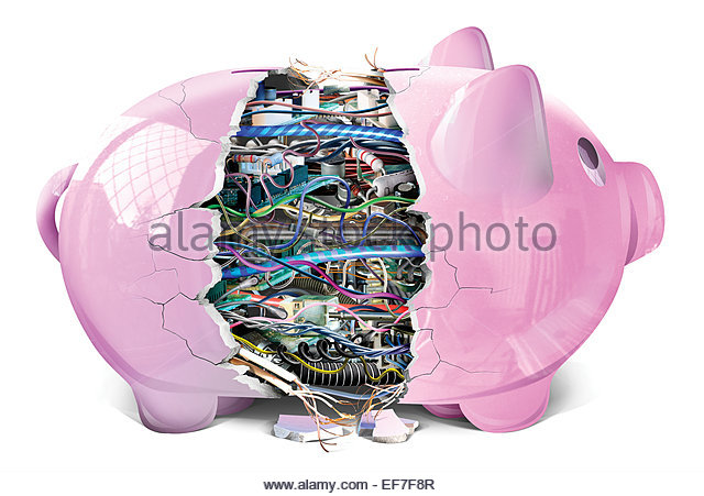 Broken piggy bank revealing complex electronics - Stock Image